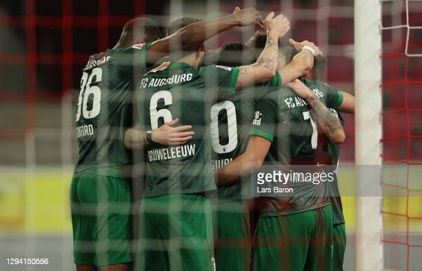 Iago of Augsburg celebrates his team's first goal with teammates during the Bundesliga match between 1. FC Koeln and FC Augsburg at...