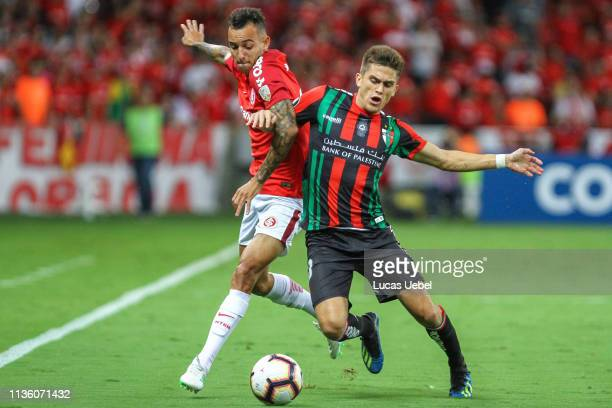 Iago of Internacional battles for the ball against Guillermo Soto of Palestino during the match between Internacional v Palestino as part of Copa...