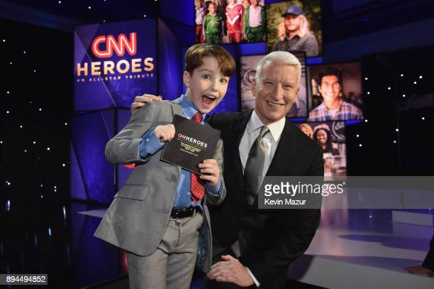 Iain Armitage and Anderson Cooper pose onstage during CNN Heroes 2017 at the American Museum of Natural History on December 17 2017 in New York City...