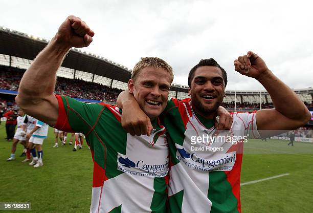 Iain Balshaw and Karmichael Hunt of Biarritz celebrate after their teams victory during the Heineken Cup semi final match between Biarritz Olympique...