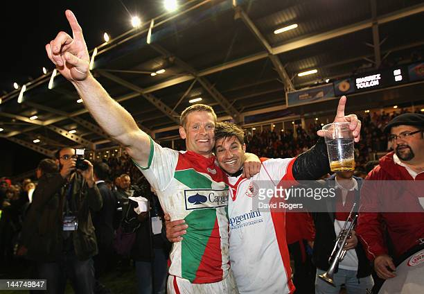 Iain Balshaw of Biarritz celebrates with a fan after their victory in the Amlin Challenge Cup Final between Biarritz Olympique and RC Toulon at the...