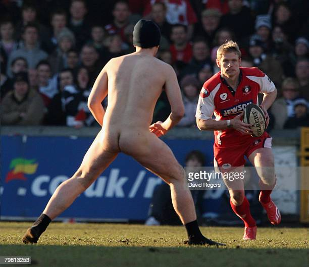 Iain Balshaw of Gloucester is confronted by a streaker during the Guinness Premiership match between Bristol and Gloucester at the Memorial Ground on...