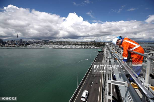 Iain Butler from Vector Energy and Maddix Rice from Coll Electrical check over the lighting strips on the Auckland Harbour Bridge on January 23 2018...
