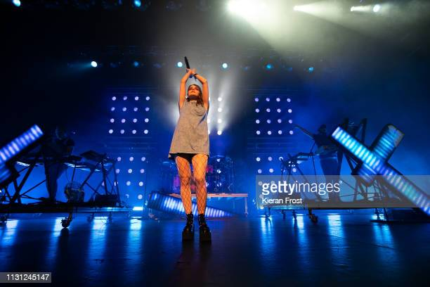 Iain Cook Lauren Mayberry and Martin Doherty of CHVRCHES at performs at the Olympia Theatre on February 21 2019 in Dublin Ireland