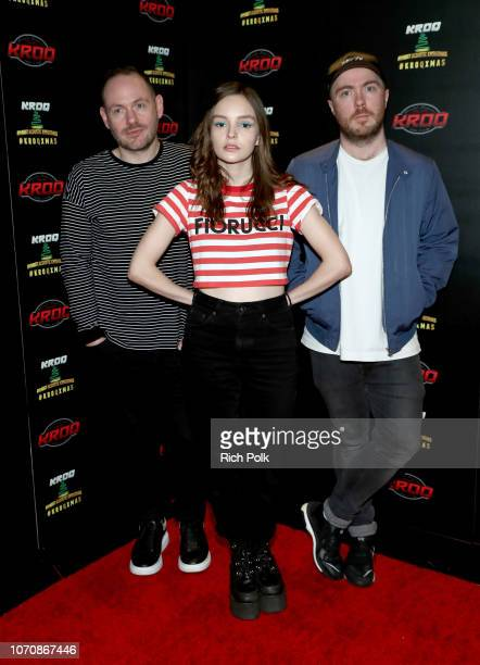 Iain Cook Lauren Mayberry and Martin Doherty of CHVRCHES attend KROQ Absolut Almost Acoustic Christmas at The Forum on December 9 2018 in Inglewood...
