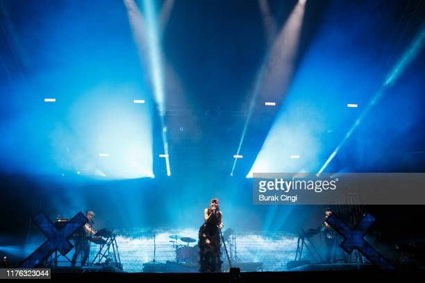 Iain Cook Lauren Mayberry and Martin Doherty of Chvrches perform live on the BBC Radio 1 stage during day three of Reading Festival 2019 at Richfield...