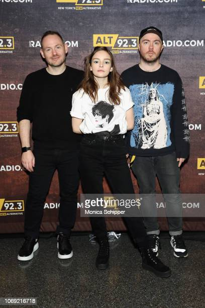 Iain Cook Lauren Mayberry and Martin Doherty of CHVRCHES pose at Not So Silent Night presented by Radiocom at Barclays Center on December 6 2018 in...