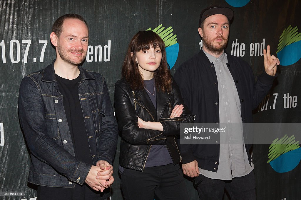 Iain Cook, Lauren Mayberry and Martin Doherty of Chvrches pose for a photo after performing an EndSession hosted by 107.7 The End at Fremont Abbey Arts Center on October 14, 2015 in Seattle, Washington.