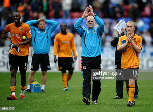 Iain Dowie of Hull City applauds the fans afteralongside Mark Cullen during the Barclays Premier League match between Wigan Athletic and Hull City at...