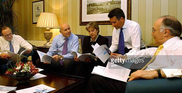 Iain Duncan Smith second left leader of the opposition Conservative Party meets with members of his shadow Cabinet from L Michael Ancram shadow...