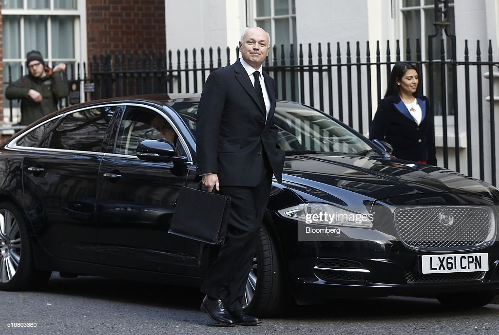 Iain Duncan Smith, U.K. work and pensions secretary, center, arrives in Downing Street in London, U.K., on Wednesday, March 16, 2016. U.K. Chancellor of the Exchequer George Osborne is set to unveil sweeping education reforms in his Budget on Wednesday as he seeks to sweeten the pill of austerity three months before the referendum on European Union membership. Photographer: Simon Dawson/Bloomberg via Getty Images