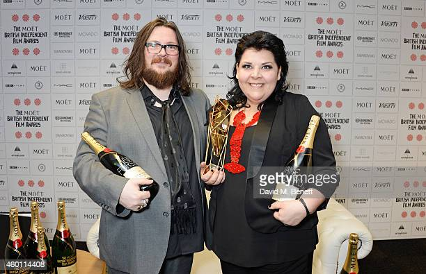 """Iain Forsyth and Jane Pollard, winners of the Douglas Hickox award for """"20,000 Days On Earth"""", pose at The Moet British Independent Film Awards 2014..."""
