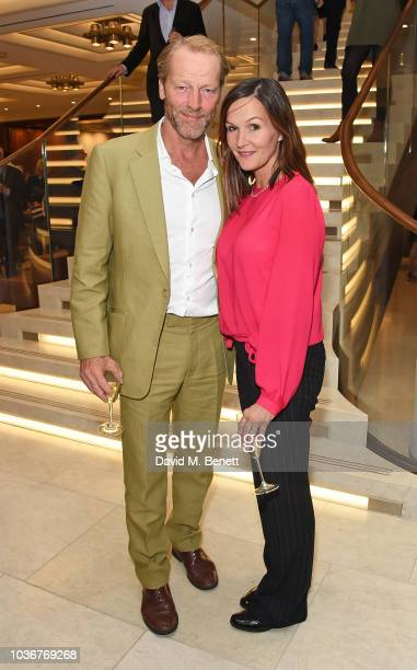 Iain Glen and guest attend the re-opening of the Royal Opera House on September 20, 2018 in London, England.