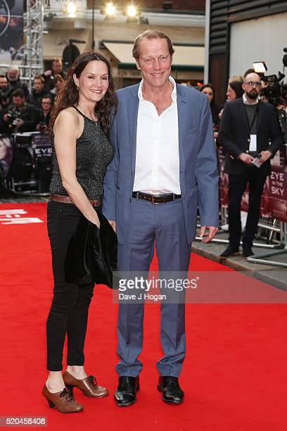Iain Glen and wife Charlotte Emmerson attend the UK premiere of Eye In The Sky at The Curzon Mayfair on April 11 2016 in London England