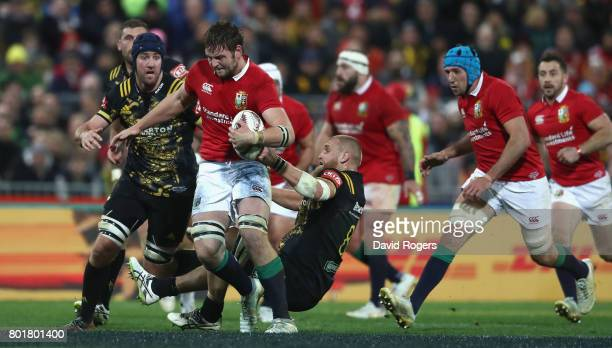 Iain Henderson of the Lions is held back by Brad Shields during the match between the Hurricans and the British Irish Lions at Westpac Stadium on...