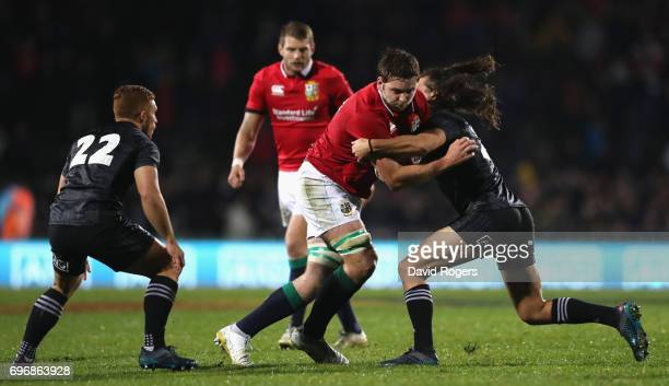 Iain Henderson of the Lions is tackled by Kara Pryor during the match between the New Zealand Maori and the British Irish Lions at Rotorua...