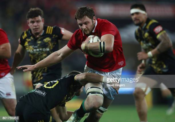Iain Henderson of the Lions is tackled by Otere Black of the Hurricanes during the 2017 British Irish Lions tour match between the Hurricanes and the...