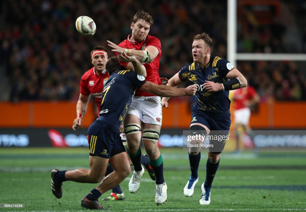 Iain Henderson of the Lions offloads as he is tackled by Dillon Hunt of the Highlanders during the 2017 British & Irish Lions tour match between the Highlanders and the British & Irish Lions at the Forsyth Barr Stadium on June 13, 2017 in Dunedin, New Zealand.