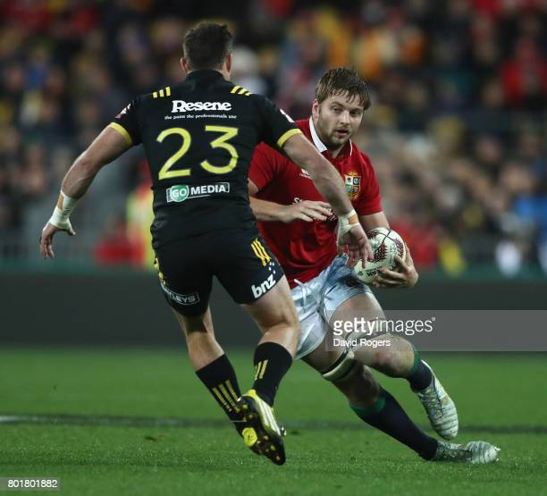 Iain Henderson of the Lions takes on Cory Jane during the match between the Hurricans and the British Irish Lions at Westpac Stadium on June 27 2017...