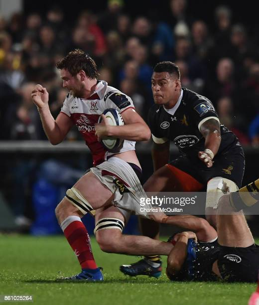 Iain Henderson of Ulster is tackled by Jake CooperWoolley of Wasps during the European Rugby Champions Cup match between Ulster Rugby and Wasps at...