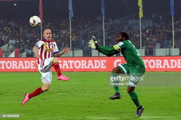 Iain Hume of Atletico de Kolkata and Chennaiyin FC goalkeeper Apoula Edel in action during their ISL semifinal second leg match at Yuva Bharati...