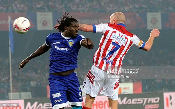 Iain Hume of Atletico de Kolkata vying for the ball with Chennaiyin FC player Bernard Mendy during their ISL semifinal second leg match at Yuva...