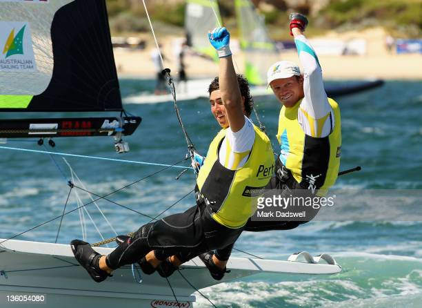 Iain Jensen and Nathan Outteridge of Australia celebrate their win in the 49er Men's Skiff Medal race on the Centre Course during day 16 of the ISAF...