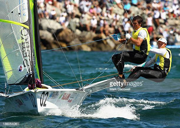 Iain Jensen and Nathan Outteridge of Australia compete in the 49er Men's Skiff Medal race on the Centre Course during day 16 of the ISAF Sailing...
