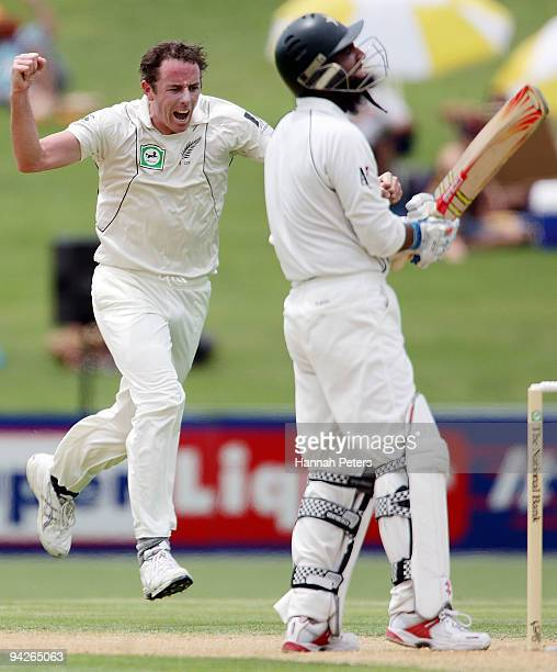 Iain O'Brien of New Zealand celebrates the wicket of Mohammad Yousf of Pakistan during day one of the Third Test match between New Zealand and...
