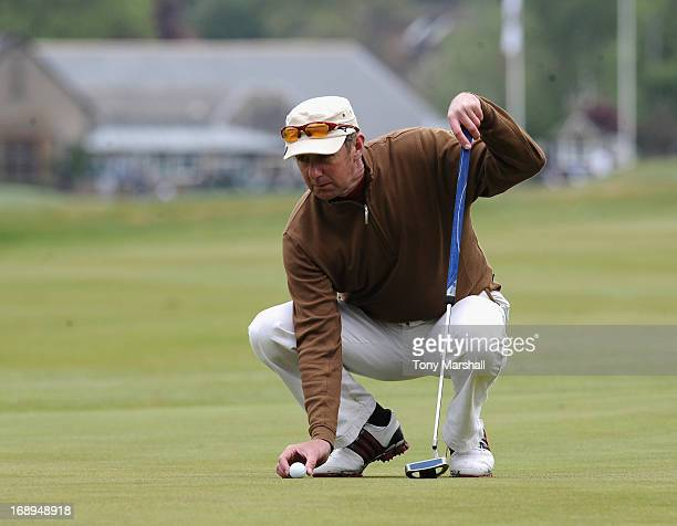Iain Parker of Royal North Devon Golf Club places the ball during the final round of the Senior PGA Professional Championship at Northamptonshire...