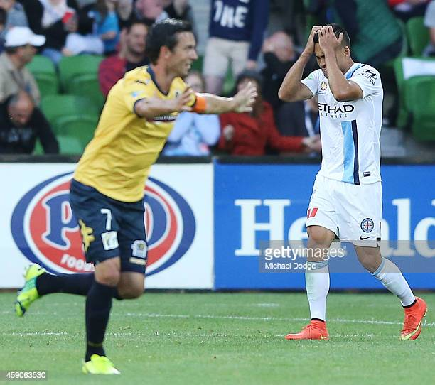 Iain Ramsay of the City reacts after John Hutchinson of Central Coast Mariners celebrates a goal in the dying stages to draw the game during the...