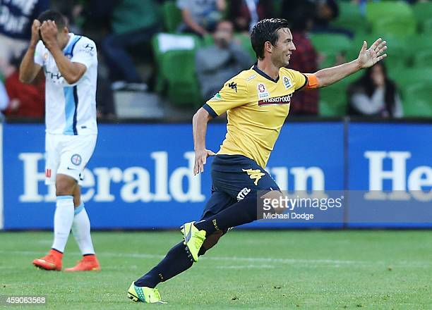 Iain Ramsay of the City reacts as John Hutchinson of Central Coast Mariners celebrates a goal in the dying stages to draw the game during the round...