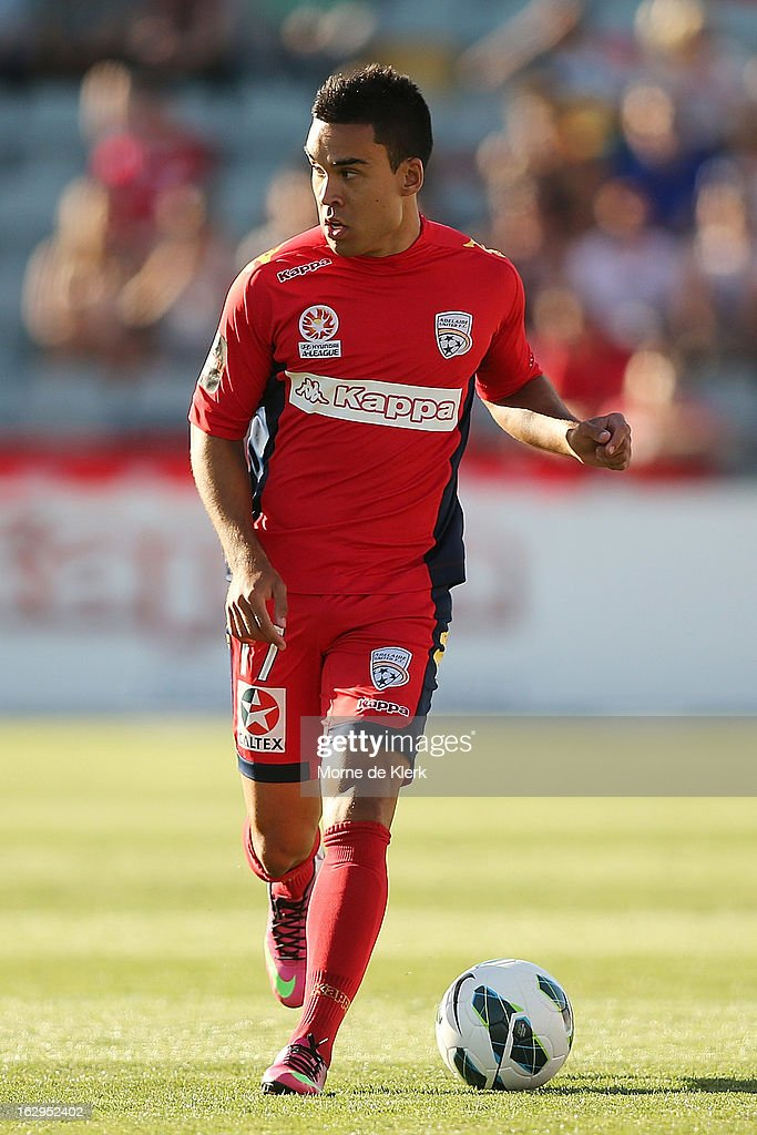 Iain Ramsey of Adelaide runs with the ball during the round 23 A-League match between Adelaide United and the Brisbane Roar at Hindmarsh Stadium on March 2, 2013 in Adelaide, Australia.