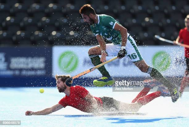 Iain Smythe of Canada and Ammad Shakeel of Pakistan battle for the ball during the Hero Hockey World League SemiFinal Pool B match between Pakistan...