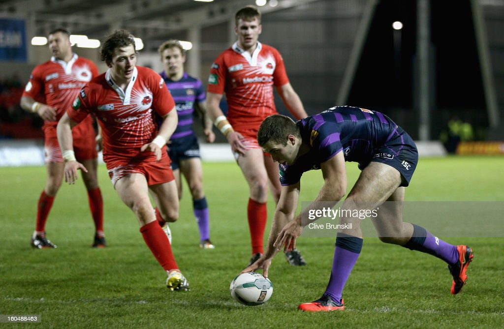 Iain Thornley of Wigan Warriors scores the fourth try during the Super League match between Salford City Reds and Wigan Warriors at Salford City Stadium on February 1, 2013 in Salford, England.