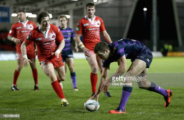Iain Thornley of Wigan Warriors scores the fourth try during the Super League match between Salford City Reds and Wigan Warriors at Salford City...