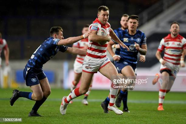 Iain Thronley of Leigh Centurions is challenged by Harry Smith of Wigan Warriors during the Betfred Super League match between Leigh Centurions and...