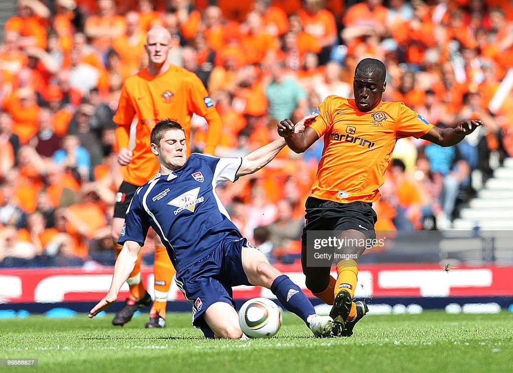Iain Vigurs of Ross County competes with Morgaro Gomis of Dundee United during the Active Nation Scottish FA Cup Final between Dundee United and Ross County at Hampden Stadium on May 15, 2010 in Glasgow, Scotland.