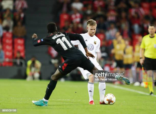 Iñaki Williams of Athletic Bilbao and Dennis Widgren of Ostersunds FK competes for the ball during the UEFA Europa League group J match between...