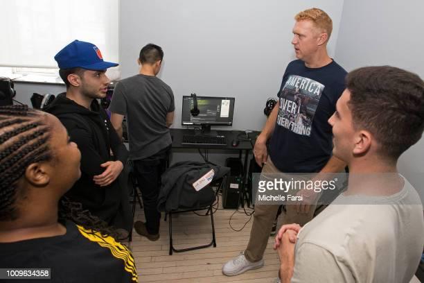 MZ_LJ iamadamthe1st Brian Scalabrine and NickTheBullsFan of Team Adam talk during the NBA 2K League Showcase on July 26 2018 at the NBA 2K Studio in...