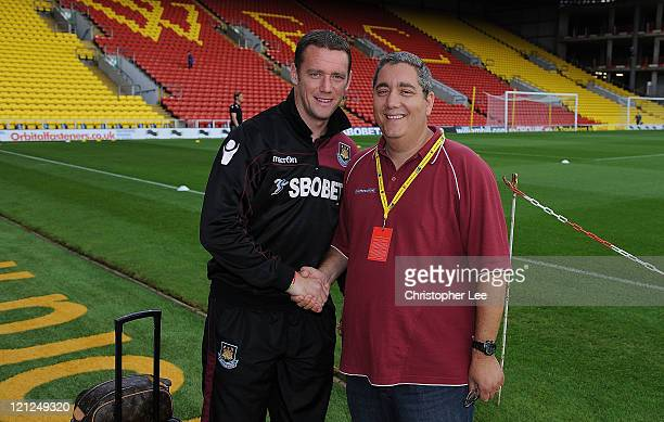 Ian Abrahams from Talksport Radio meets Kevin Nolan of West Ham United prior to the npower Championship match between Watford and West Ham United at...