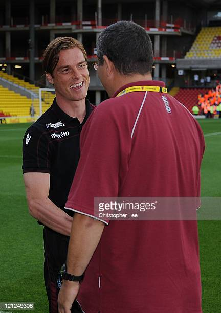 Ian Abrahams from Talksport Radio talks to Scott Parker of West Ham United prior to the npower Championship match between Watford and West Ham United...