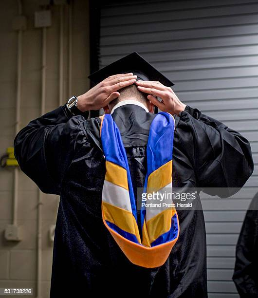 Ian Adams of Portland adjusts his graduation cap before marching in the 136th USM commencement ceremony at the Cross Insurance Arena Saturday May 14...