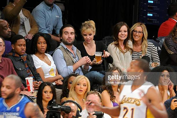 Ian Alexander Jr Regina King Johnny Galecki Kelli Garner Samantha Droke and Ashley Tisdale attend a basketball game between the Orlando Magic and the...