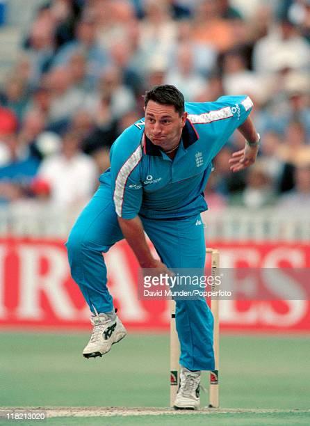 Ian Austin bowling for England circa 1998