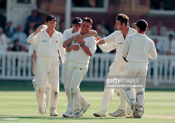 Ian Austin of Lancashire celebrates after taking the wicket of David Capel caught by Warren Hegg for 0 during the Benson Hedges Cup Final against...