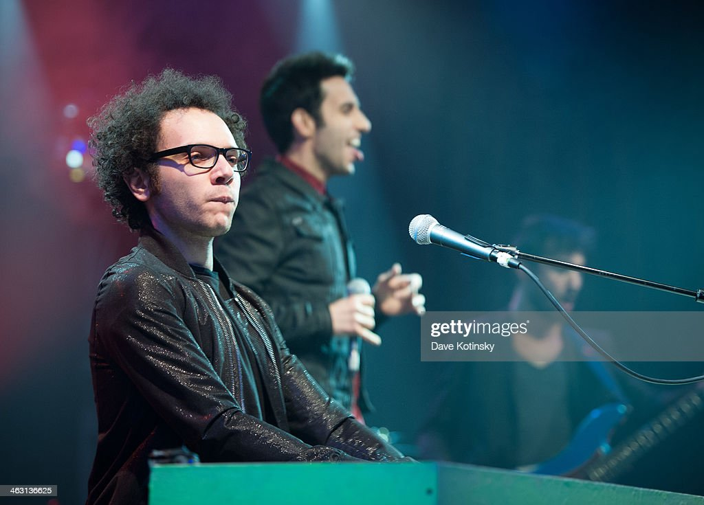 Ian Axel (L) and Chad Vaccarino (C) of A Great Big World perform at Highline Ballroom on January 16, 2014 in New York City.
