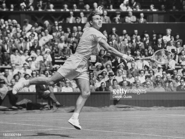 Ian Ayre of the Australia reaches to make a backhand return against compatriot Mervyn Rose during their Men's Singles First Round match on Centre...