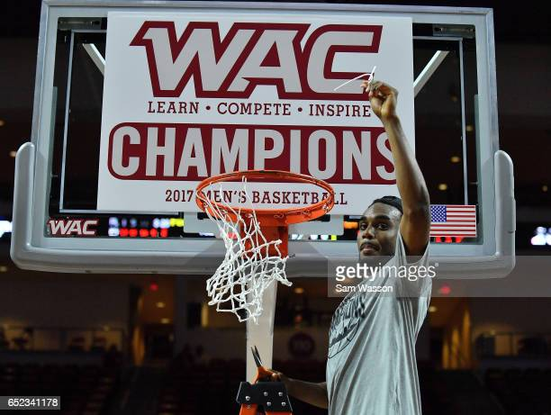 Ian Baker of the New Mexico State Aggies reacts after cutting down a piece of a net following the team's 7060 win over the Cal State Bakersfield...