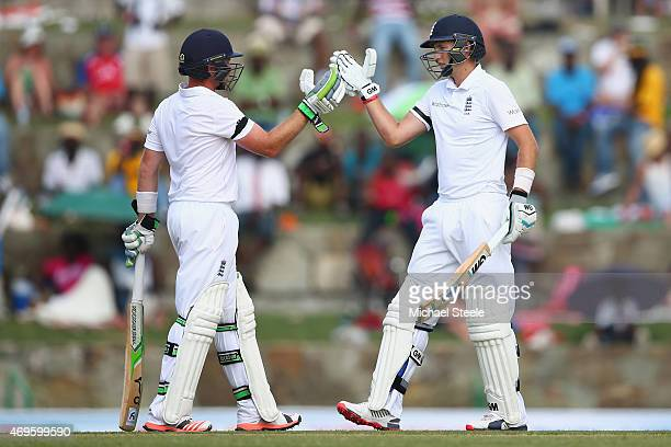 Ian Bell and Joe Root of England bring up their 150 run partnership during day one of the 1st Test match between West Indies and England at the Sir...